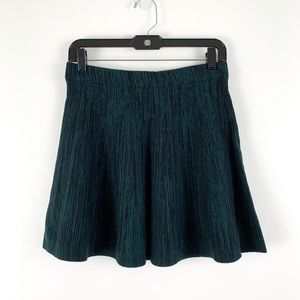 Candie's skater-style knit sweater skirt, teal and black, size small